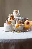 Greek yogurt, peach, mango and granola with honey and bee pollen, gluten free