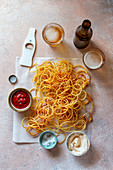 Spiralized potato fries served with ketchup and mayonnaise