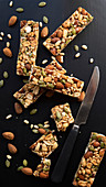 Nut and Seed Bars with a knife on a black blackground