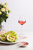 Prawns in lettuce leaves served with rosé wine