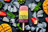 Strawberry, mango, kiwi and blueberry ice cream pop with fruits