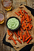 Avocado and greek yogurt dip wiht lime and cilantro, served with Sweet Potato Fries