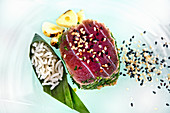 Tuna fish with a herb crust served with rice and sesame seeds (Vietnam)