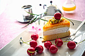 A slice of passion fruit cake with cherries