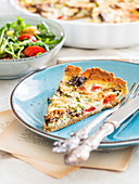 Slice of Gluten-Free Sundried Tomato and Arugula Quiche