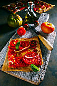Tomato tart with onion and basil over puff pastry