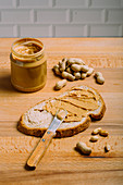 Preparing a peanut butter sandwich
