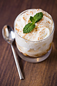 Rice pudding in a glass with cinnamon and mint