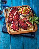 Baby back ribs in plum sauce with stone fruit slaw