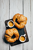 Espresso coffee cups and croissants