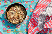 Cake in springform pan and handmade oilcloth cake bag
