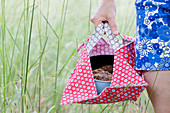 Woman carrying cake in springform pan in handmade oilcloth cake bag
