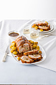 Turkey roulade with a minced pork and chestnut filling served with baked potatoes