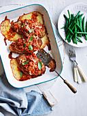 Überbackene Kalbsschnitzel mit Tomaten und Parmesan