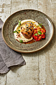 Veal fillet with an olive and tomato crust on a peperonata medley