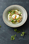 Asparagus and pea ragout with poached egg and wild broccoli