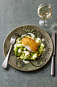Zander in a potato crust with cucumber salad and mustard sauce