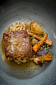 Braised Shoulder of Lamb with Spiced Pearl Barley and Vegetables