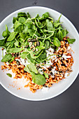 Warm pasta salad with rocket