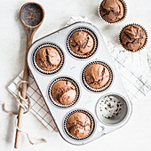 Chocolate muffins in a baking tin