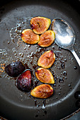 Fried figs in a pan (top view)