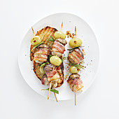 Mushroom skewers with bacon and grapes