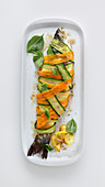 Bass wrapped carrot and courgettes