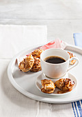 Small apple pies with honey and almonds, served with coffee