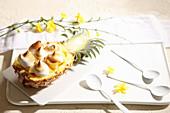Stuffed pineapple with meringue kisses