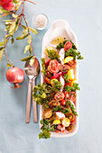 Vegetable salad with pomegranates and kale