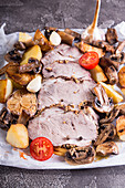 Cold-boiled pork with mushrooms, potato, garlic and cherry tomatoes