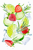 Lime, cucumber, strawberry and rosemary flying with ices and water splash