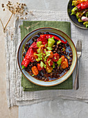 Black chickpeas with roasted peppers and tomatoes