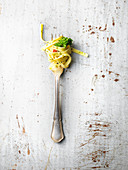Tagliatelle with tender stem broccoli on fork
