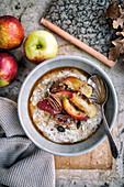 Autumn porridge with maple syrup and apples