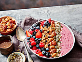 Breakfast bowl with blueberry, blackberry, strawberry, nuts and granola
