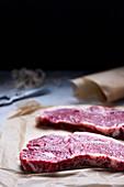 Raw New York strip steaks
