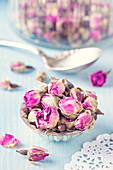 Dried rosebuds for tea in an old muffin tin