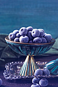 Frozen blueberries in a vintage bowl