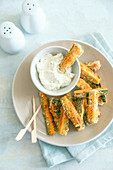 Stick of breaded and oven-baked zucchini with ricotta and mayonnaise cream