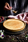 A dusting of cinnamon over a tart