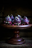 Gorgeous purple figs dipped in dark chocolate sprinkled with coconut and rose petals