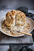 Roasted Cauliflower with almonds in a cheese sauce