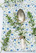 Sprigs of calamint tied to vintage spoon