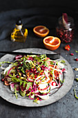 Vegetable salad with blood oranges and pomegranate seeds