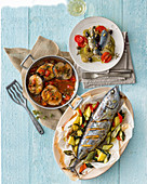 Small tuna fish with oven cooked vegetables, bonito with tomatoes, capers and oregano, and mackerel rolls with potatoes, tomatoes and pine nuts