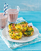 Breakfast broccoli ham quiches and berry mango smoothie