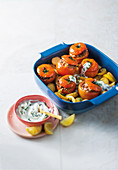 Greek-style stuffed tomatoes with mint and couscous