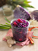 Pineapple and red cabbage with ginger in a preserving jar