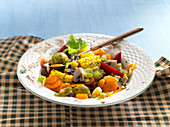Vegetable stew with corn on the cob